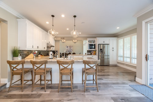 four brown wooden chairs in kitchen